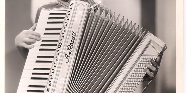 Ginger Rogers and her accordion.