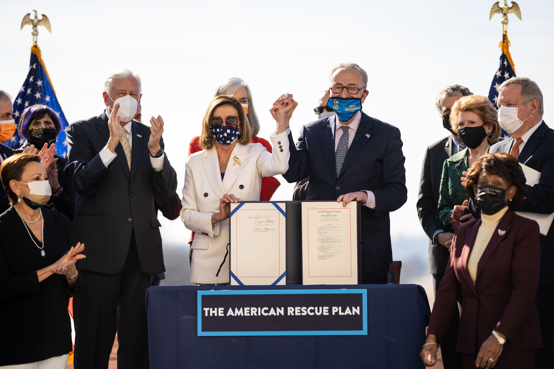 Speaker of the House Nancy Pelosi (D-Calif.) and Senate Majority Leader Chuck Schumer (D-N.Y.), center, sign H.R. 1319 Americ