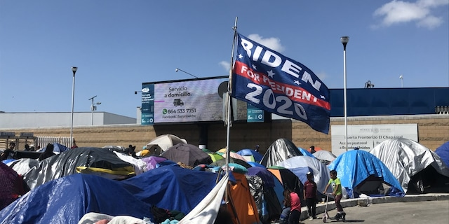 """A """"Biden for president 2020'"""" flag flies over a migrant camp on the U.S. southern border. Some migrants have said they chose to make the trip to the United States now because Biden won the presidential election. Biden has denied that his campaign rhetoric and policies are fueling the immigration surge. (Griff Jenkins/Fox News)."""