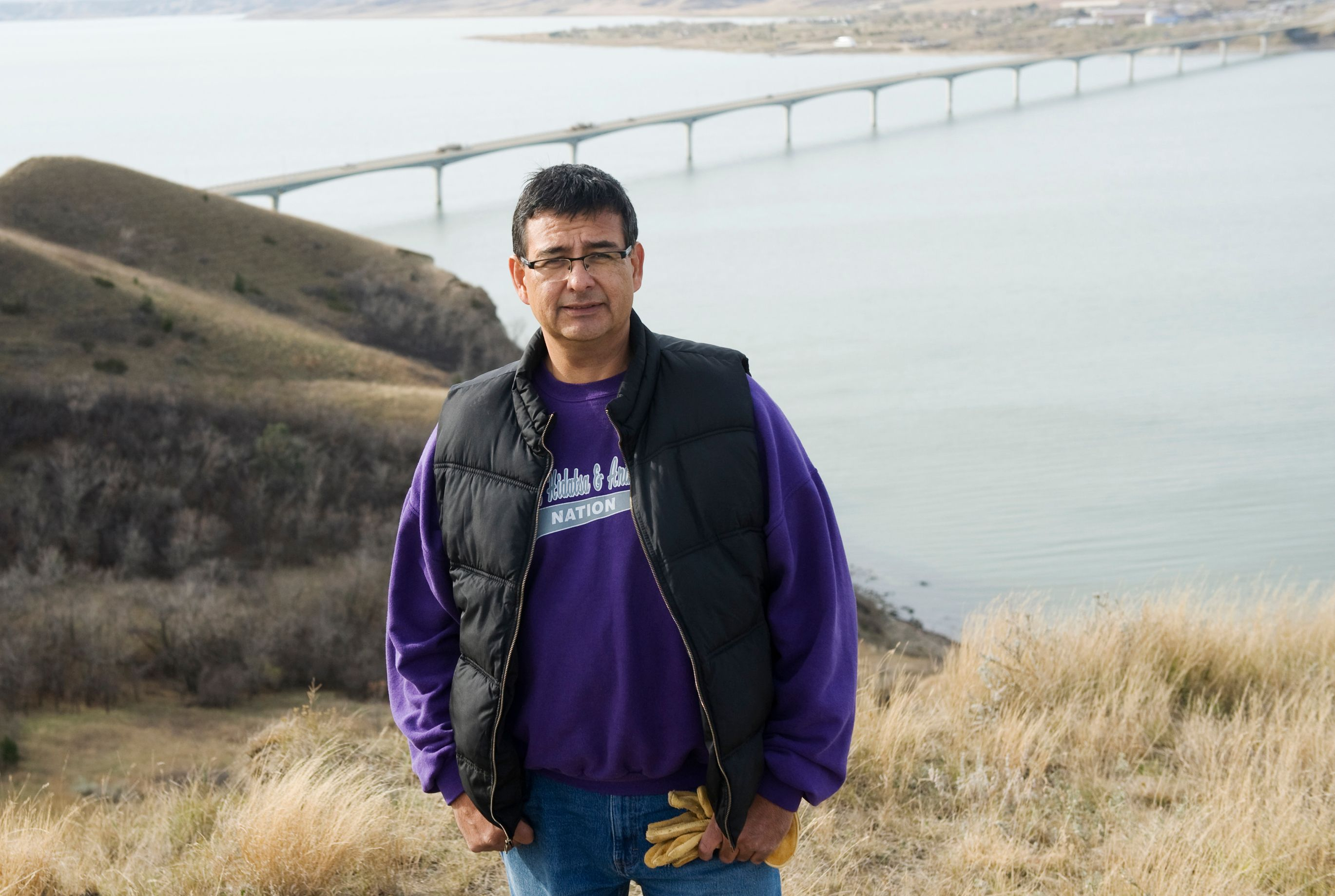 Mark Fox, who was running for tribal chairman at the time, poses at Crow Flies High Butte above the Missouri River in North D