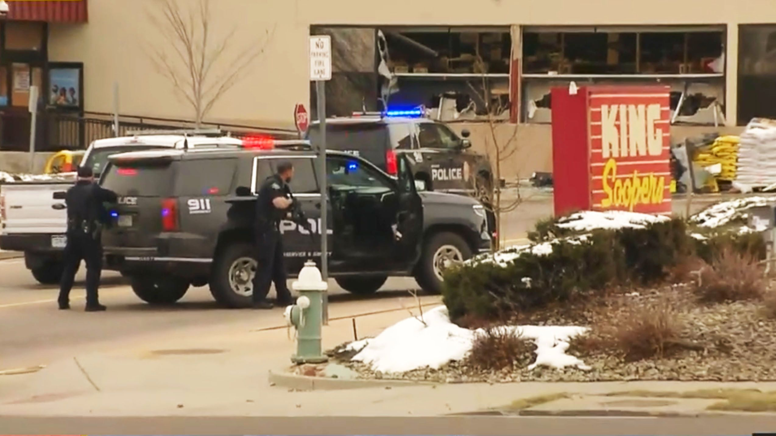 Police take positions outside the King Soopers grocery store in Boulder, Colorado, on Monday after reports of an active shoot