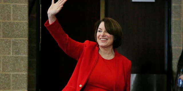 Sen. Amy Klobuchar, D-Minn., waves as she arrives to speak to the Scott County Iowa Democrats Saturday, Jan. 25, 2020, in Bettendorf, Iowa.