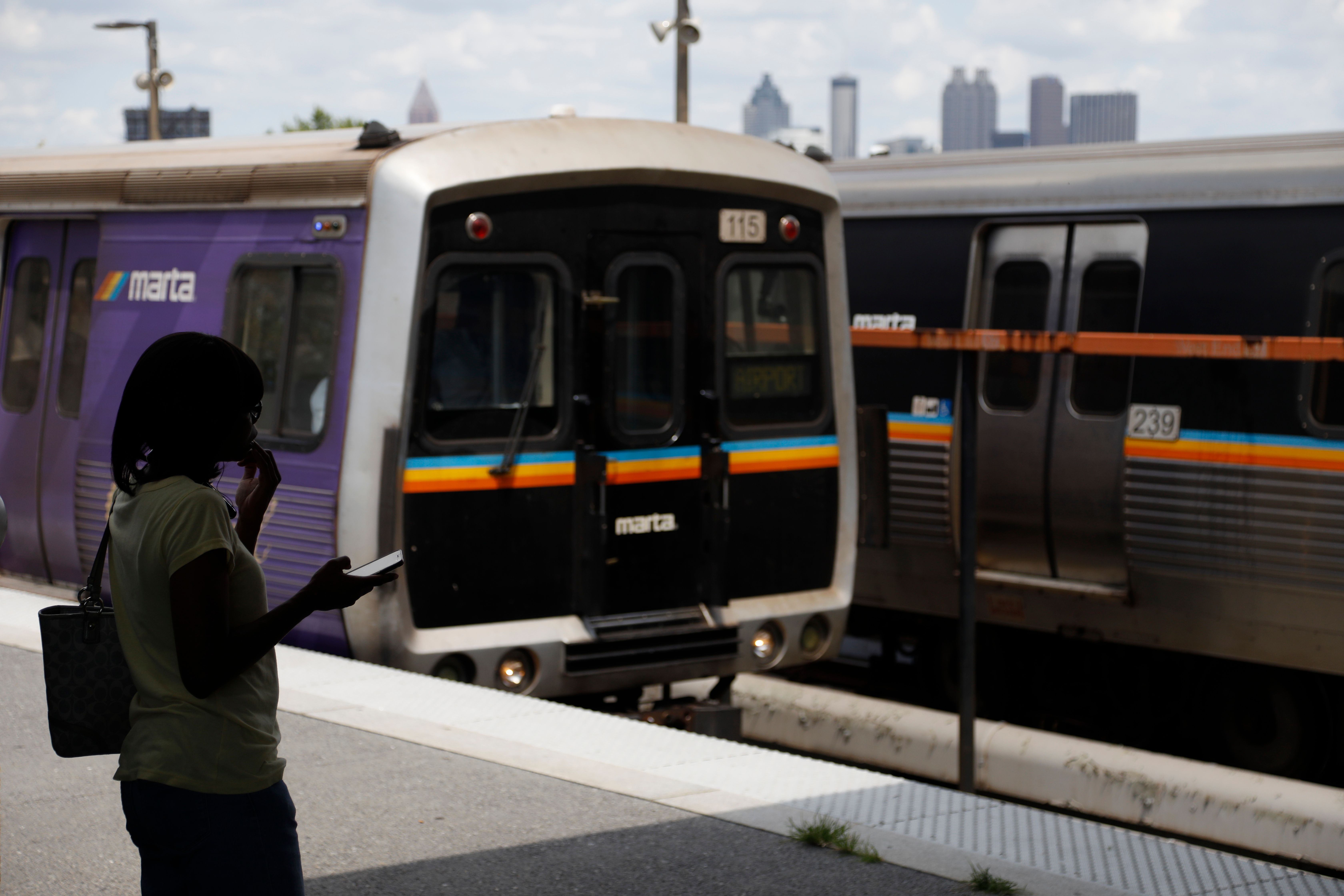 In this Tuesday, Aug. 20, 2019, photo, a woman waits to board a Metropolitan Atlanta Rapid Transit Authority train at West En