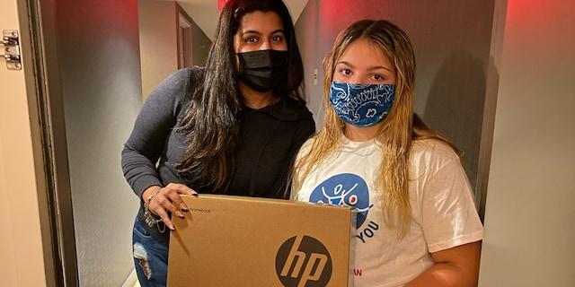 Daisy Hampton collecting laptop donations (Credit: Jen Hampton)