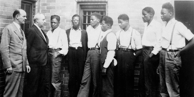 Just after he asked the Governor of Alabama to pardon the nine youths held in the Scottsboro case, Samuel Leibowitz, New York attorney, conferred with seven of the defendants, May 1, 1935, at the Scottsboro jail. Left to right are: Deputy Sheriff Charles McComb, Leibowitz, and the defendants, Roy Wright, Olen Montgomery, Ozie Powell, Willie Robertson, Eugene Williams, Charlie Weems, and Andy Wright. The youths were charged with an attack on two white women on March 25, 1931. (AP Photo)