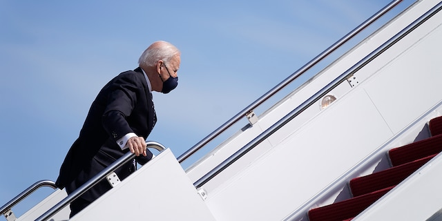President Biden recovers after stumbling while boarding Air Force One at Andrews Air Force Base, Md., Friday, March 19, 2021. Biden was en route to Georgia. (AP Photo/Patrick Semansky)