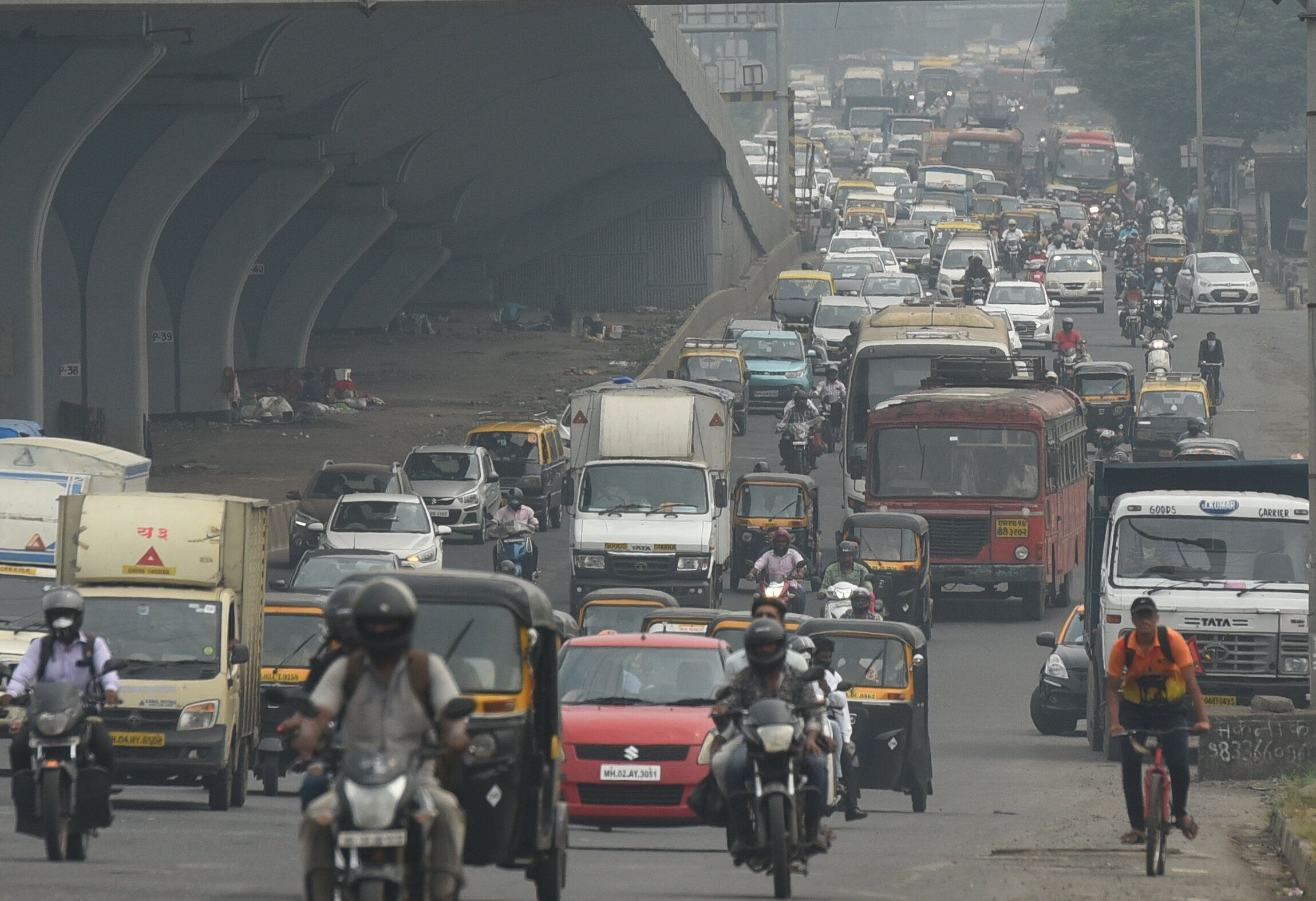 Huge traffic is seen in Mumbai, India, after local train services stopped due to a power failure, Oct. 12, 2020.