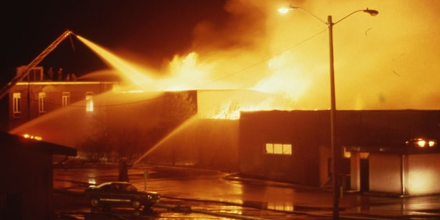 A man was charged this week in the alleged arson at Everett Community College more than three decades ago that killed a responding firefighter.