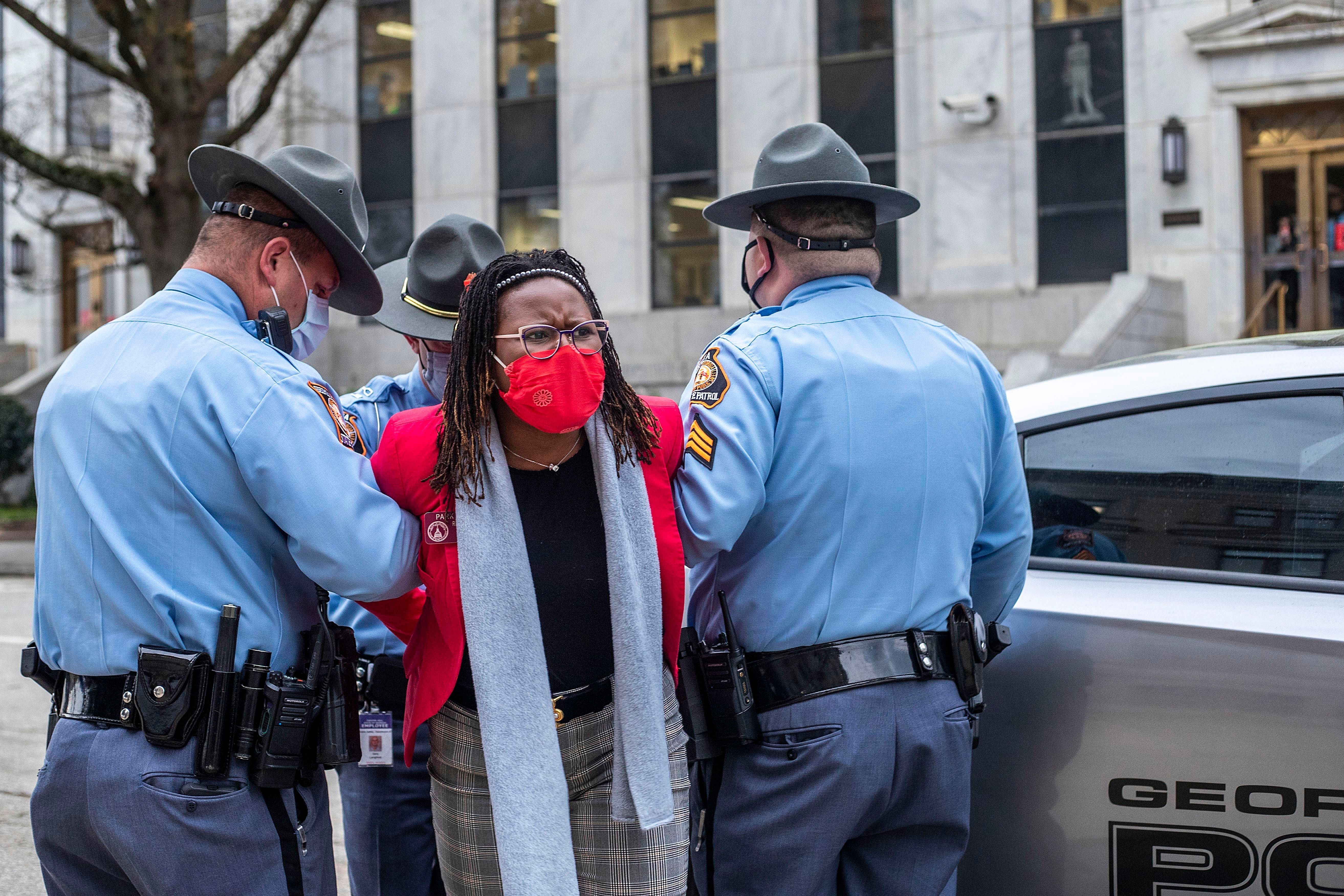 State Rep. Park Cannon (D) is placed into the back of a Georgia State Capitol patrol car after being arrested by Georgia stat