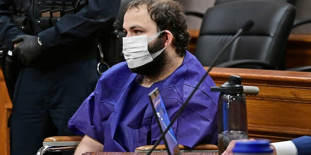 """Ahmad Al Aliwi Alissa, 21, appears before Boulder District Court Judge Thomas Mulvahill at the Boulder County Justice Center in Boulder, Colo. on March 25, 2021. Three days after he was led away in handcuffs from a Boulder supermarket where 10 people were fatally shot, Alissa appeared in court for the first time and his defense lawyer asked for a mental health assessment """"to address his mental illness."""" (Helen H. Richardson/The Denver Post via AP, Pool)"""