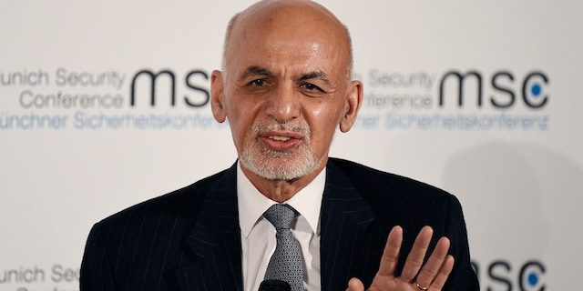 Afghan President Ashraf Ghani speaks on the second day of the Munich Security Conference in Munich, Germany, Saturday, Feb. 15, 2020. (AP Photo/Jens Meyer)
