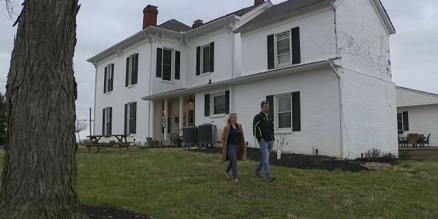 Brad and Dani Cochran outside their farmhouse in Martinsville, Ohio.
