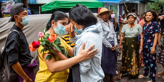 An anti-coup student protester is welcomed home with flowers by the residents of her neighborhood after being released from jail, Friday, March 26, 2021, in Yangon, Burma. (AP Photo)
