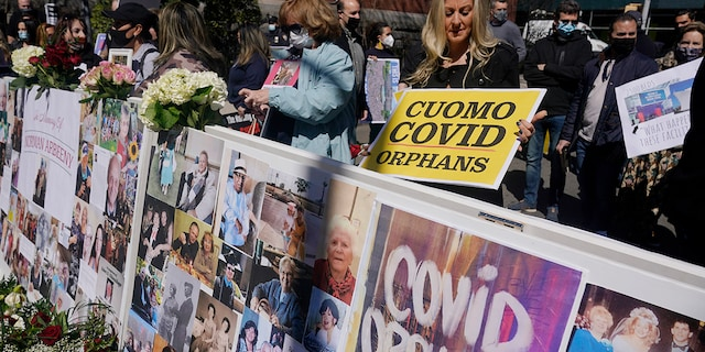 Families who had relatives that died from COVID-19 in nursing homes gather before the start of a news conference in New York, Sunday, March 21, 2021. The families gathered to grieve but want an investigation into and accountability from Gov. Andrew Cuomo. (AP Photo/Seth Wenig)