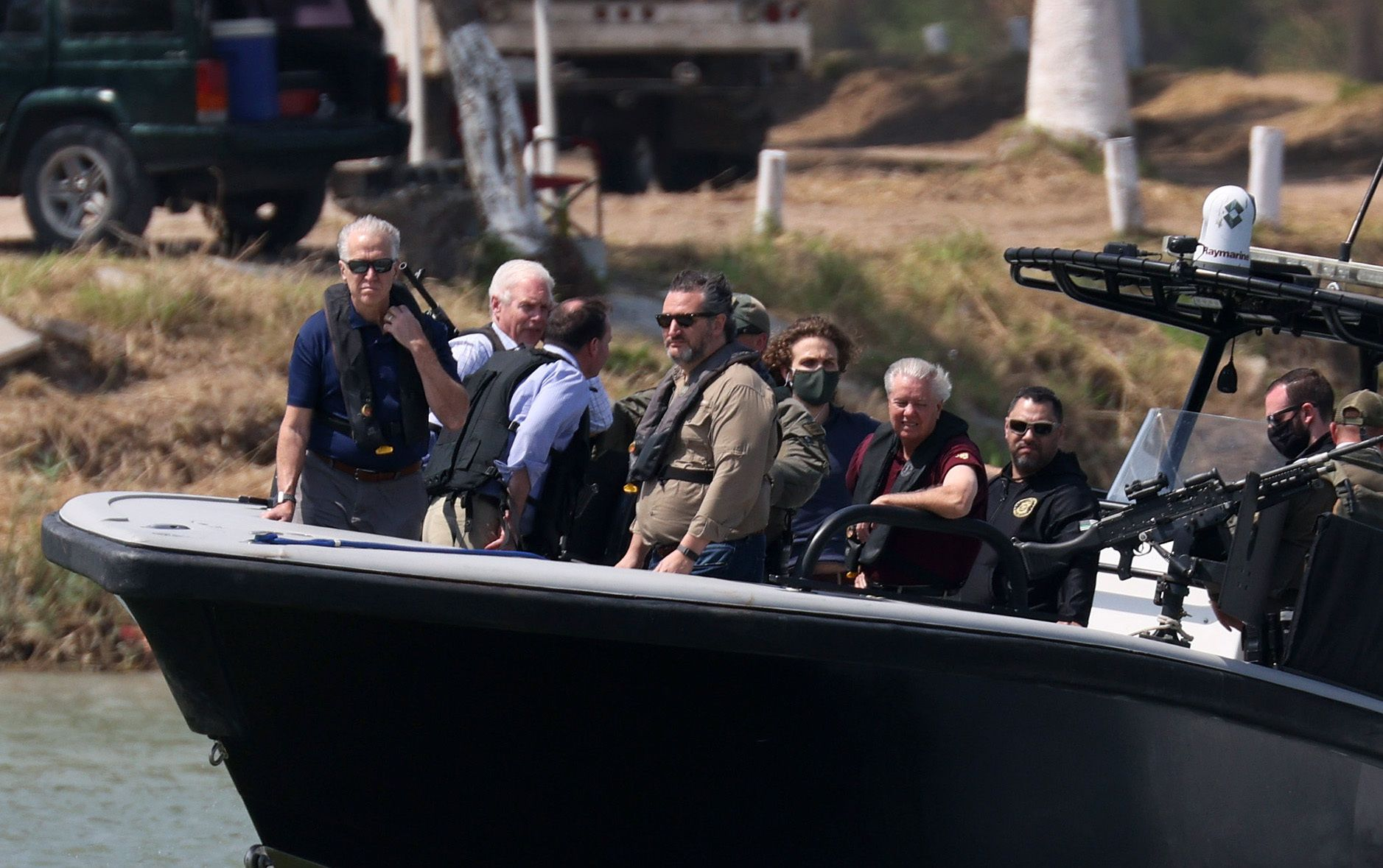 Sens. Ted Cruz (R-Texas) and Lindsey Graham (R-S.C.), third and fifth from left, are seen with others aboard a Texas Departme