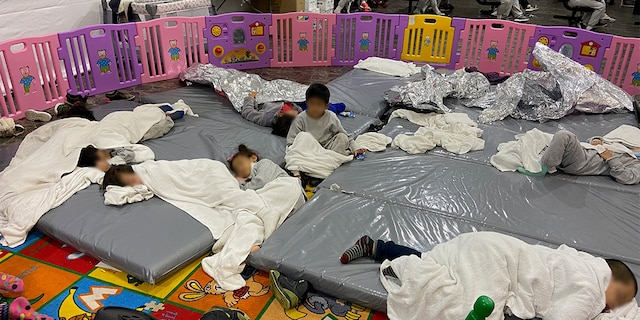 Images of migrant children taken Friday, March 26, 2021, at the Donna U.S. Customs and Border Protection (CBP) facility in Texas. Sen. Mike Braun, R-Ind., took the pictures while touring the facility with other GOP senators.