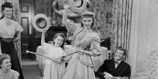 Actresses Margaret O'Brien and Judy Garland dancing with hats and canes, in a scene from the movie 'Meet Me in St Louis', 1944.