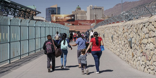"""Migrants who had been in Mexico under the Migrant Protection Protocols, or the """"Remain in Mexico"""" program, enter the United States at the Paso del Norte Bridge in El Paso, Texas on March 10, 2021. (Photo by Paul Ratje / AFP) (Photo by PAUL RATJE/AFP via Getty Images)"""