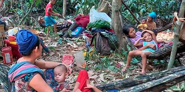 In this photo released by the Free Burma Rangers, Karen villagers gather in the forests as they hide from military airstrikes in the Deh Bu Noh area of the Papun district, north Karen state, Burma, Sunday, March 28, 2021. (Free Burma Rangers via AP)