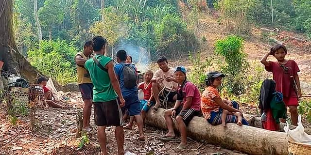 In this photo released by the Free Burma Rangers, Karen villagers gather in the forests as they hide from military airstrikes in the Deh Bu Noh area of the Papun district, north Karen state, Burma, Sunday, March 28, 2021. Thai authorities along its northwestern border braced themselves, Monday, for a possible influx of more ethnic Karen villagers fleeing the fear of renewed air strikes from the Burma military. (Free Burma Rangers via AP)