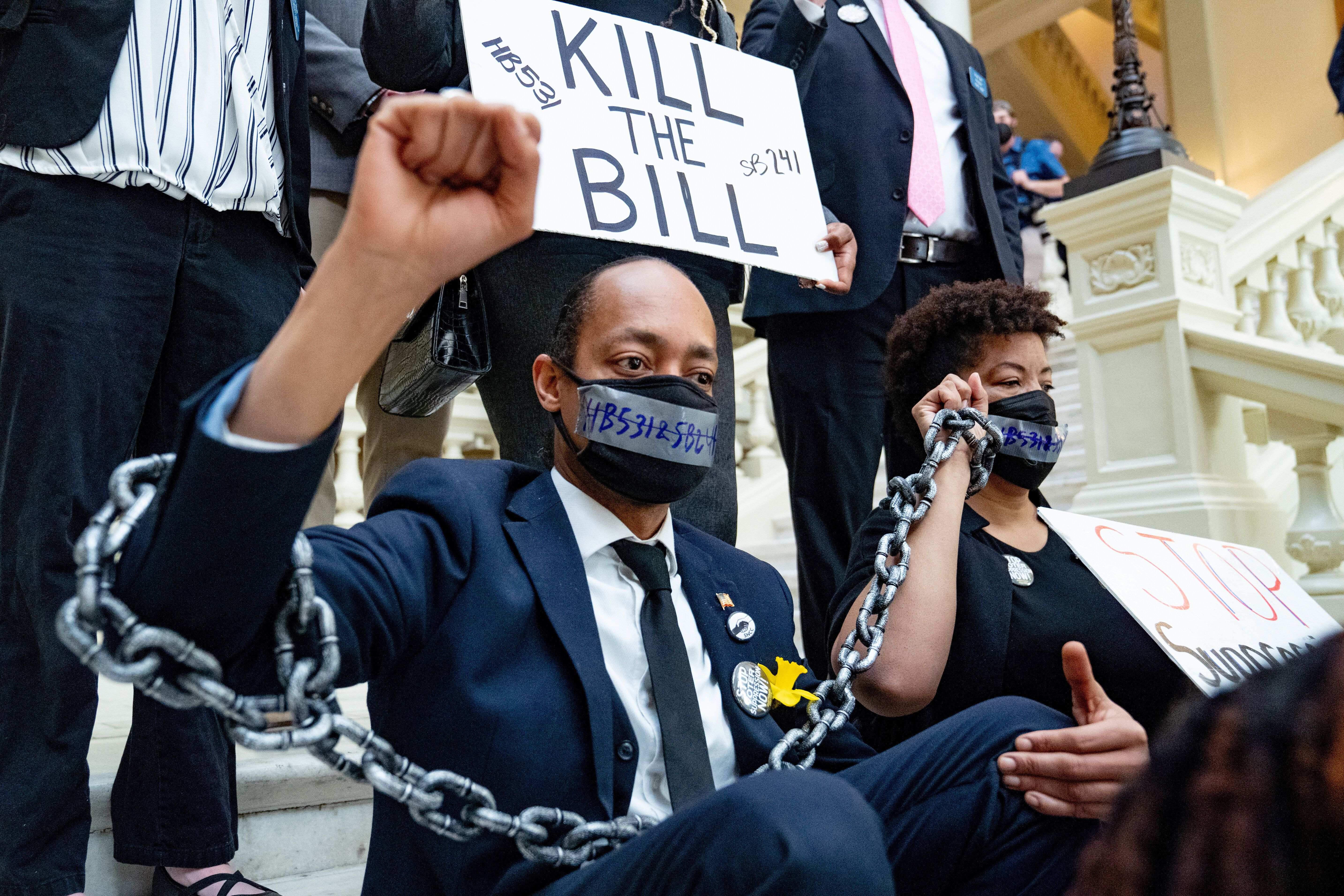Demonstrators hold a sit-in inside the Georgia Capitol in opposition to H.B. 531, which imposes new restrictions on voting in