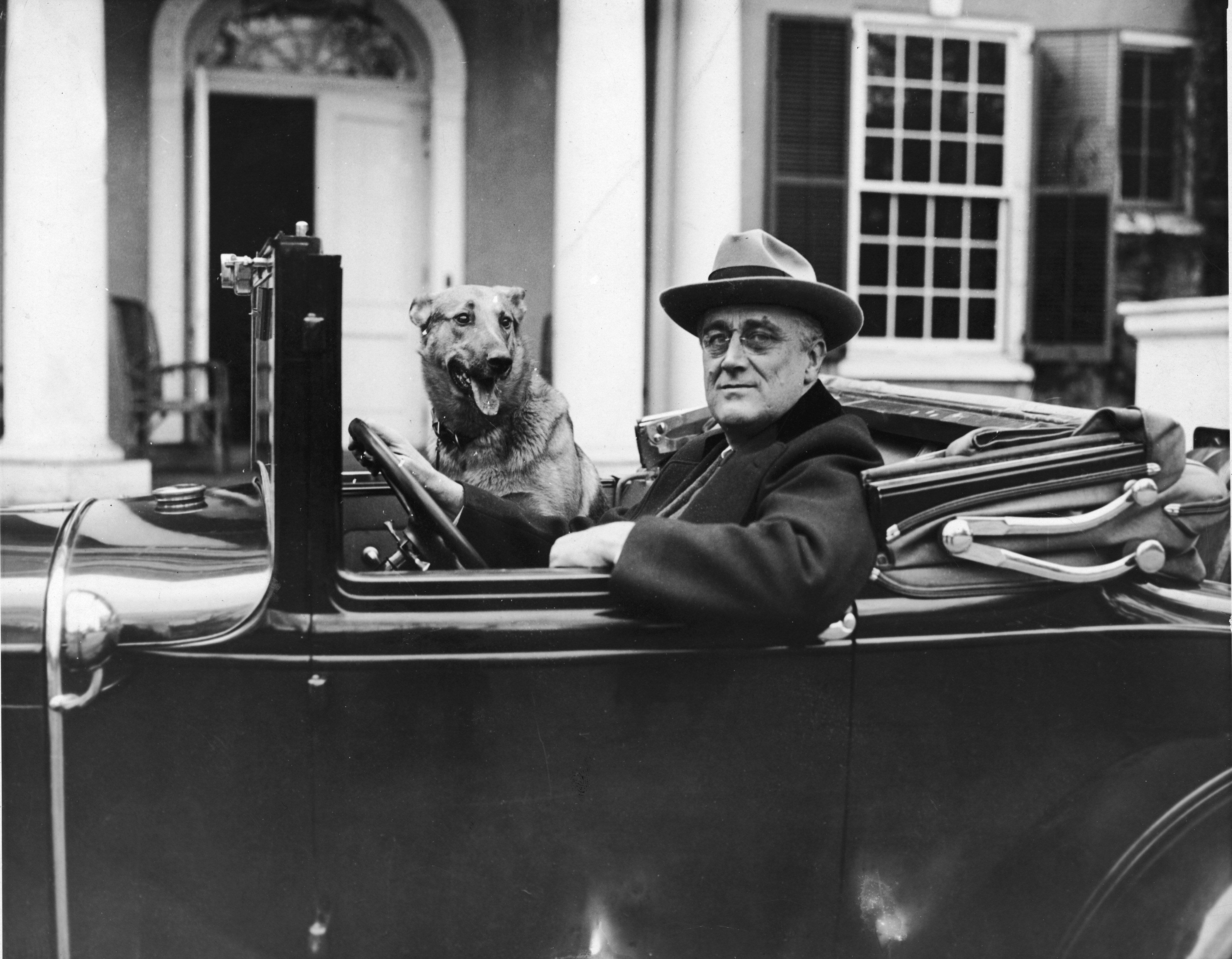 President Franklin Delano Roosevelt and Major outside their home in Hyde Park, New York.