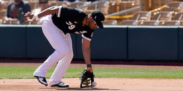Chicago White Sox first baseman Jose Abreu fields a ground ball hit by San Francisco Giants' Jason Vosler during the second inning of a spring training baseball game Monday, March 22, 2021, in Phoenix. (AP Photo/Ross D. Franklin)