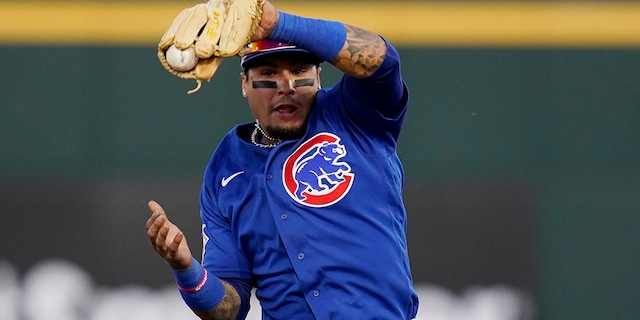 Chicago Cubs shortstop Javier Baez makes a leaping catch on a line drive hit by Cincinnati Reds' Jonathan India during the second inning of a spring training baseball game Saturday, March 27, 2021, in Goodyear, Ariz. (AP Photo/Ross D. Franklin)