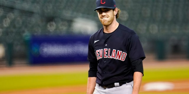 Shane Bieber has reported to training camp with the Cleveland Indians after recovering from COVID-19. The right-hander took part in drills on Saturday, Feb. 20, 2021, a day before the Indians hold their first full-squad workout in Goodyear, Ariz. (AP Photo/Paul Sancya, File)