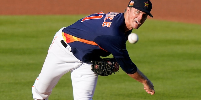Houston Astros starting pitcher Zack Greinke throws during the first inning of the team's spring training baseball game against the Miami Marlins, Friday, March 26, 2021, in West Palm Beach, Fla. (AP Photo/Lynne Sladky)
