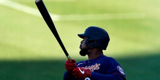 Minnesota Twins' Byron Buxton follows through on a three-run double during the first inning of the team's spring training baseball game against the Boston Red Sox on Thursday, March 25, 2021, in Fort Myers, Fla. (AP Photo/John Bazemore)