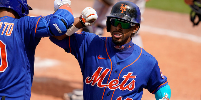 New York Mets' Francisco Lindor (12) is congratulated by Michael Conforto after scoring on a solo home run during the fifth inning of a spring training baseball game Miami Marlins, Tuesday, March 23, 2021, in Port St. Lucie, Fla. (AP Photo/Lynne Sladky)