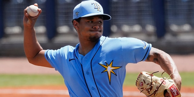 Tampa Bay Rays starting pitcher Chris Archer (22) delivers in the second a spring training baseball game against the Minnesota Twins on Wednesday, March 24, 2021, in Port Charlotte, Fla. (AP Photo/John Bazemore)