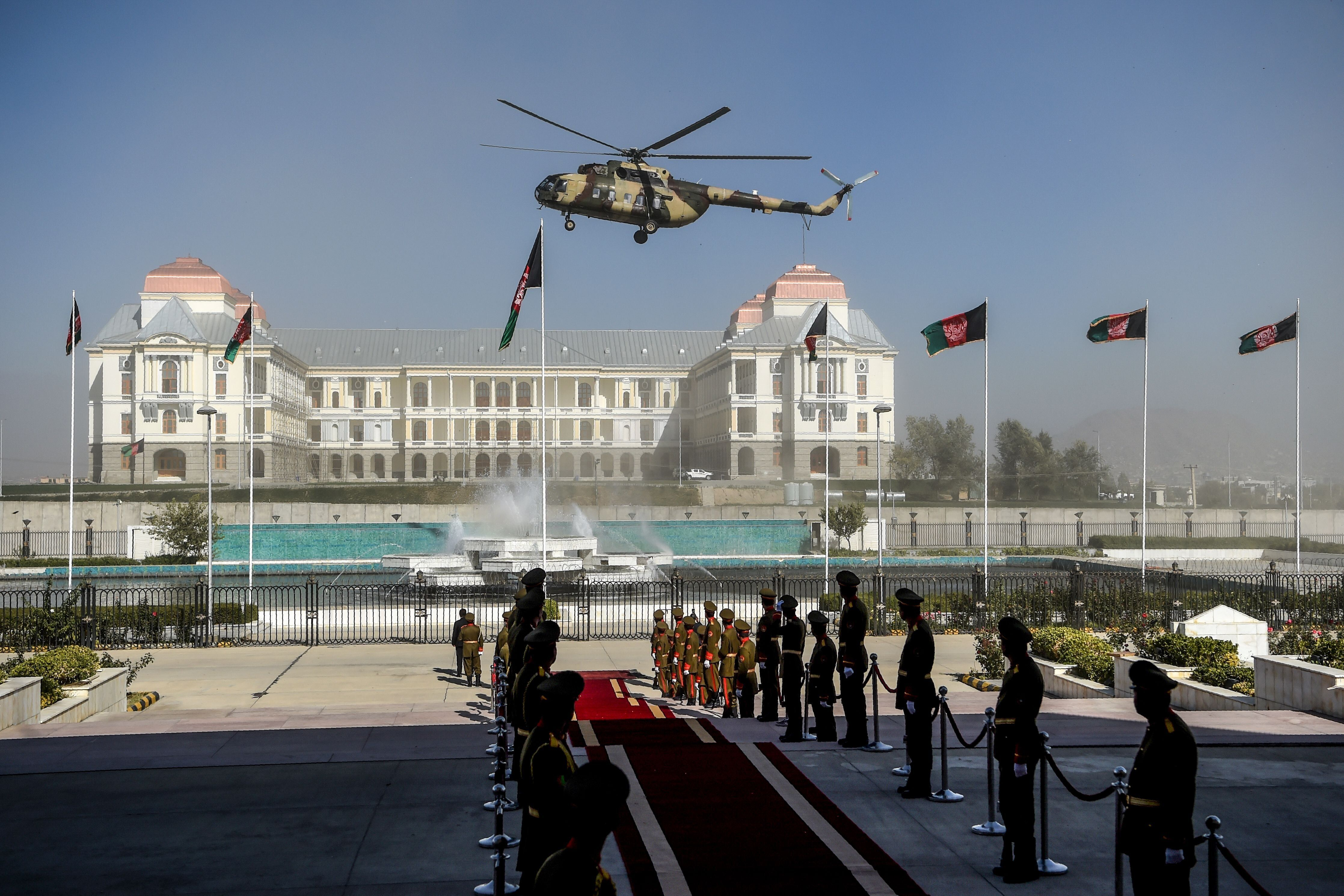 An Afghan Air Force helicopter flies over ahead of the arrival of Afghanistan's President Ashraf Ghani for the introduction o