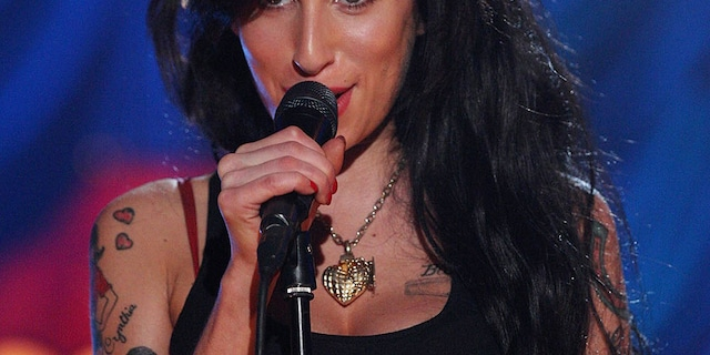 British singer Amy Winehouse performs at The Riverside Studios for the 50th Grammy Awards ceremony via video link on February 10, 2008, in London, England.