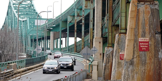 Drivers take an exit ramp off the Tobin Memorial Bridge, Wednesday, March 31, 2021, in Chelsea, Mass. (AP Photo/Steven Senne)