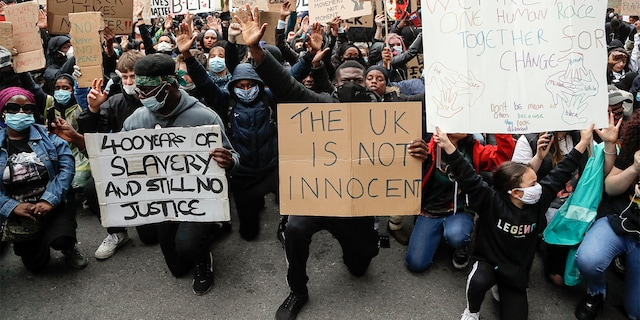 FILE - In this file photo dated Saturday, June 6, 2020, demonstrators gather outside Downing Street during a Black Lives Matter march in London. (AP Photo/Frank Augstein, FILE)