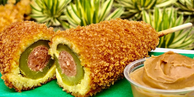 "The Pickle Corn Dog, which can be found at Disneyland's Blue Ribbon Corn Dogs Cart in Downtown Disney, is described as a ""panko-crusted dill pickle corn dog served with a side of peanut butter."""