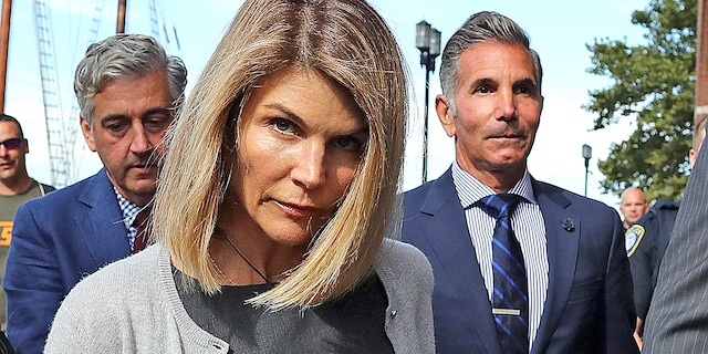 Lori Loughlin and husband Mossimo Giannulli leave the John Joseph Moakley United States Courthouse in Boston on Aug. 27, 2019.