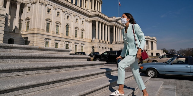 "Rep. Alexandria Ocasio-Cortez (D-NY) walks up the steps to the House on Capitol Hill on Thursday, March 11, 2021 in Washington, DC. The firebrand liberal House member has called for trillions more in spending than President Biden is proposing in his ""American Jobs Plan."" (Kent Nishimura / Los Angeles Times via Getty Images)"