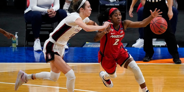 Arizona guard Aari McDonald (2) drives past Stanford guard Lexie Hull, left, during the second half of the championship game in the women's Final Four NCAA college basketball tournament, Sunday, April 4, 2021, at the Alamodome in San Antonio. (AP Photo/Eric Gay)