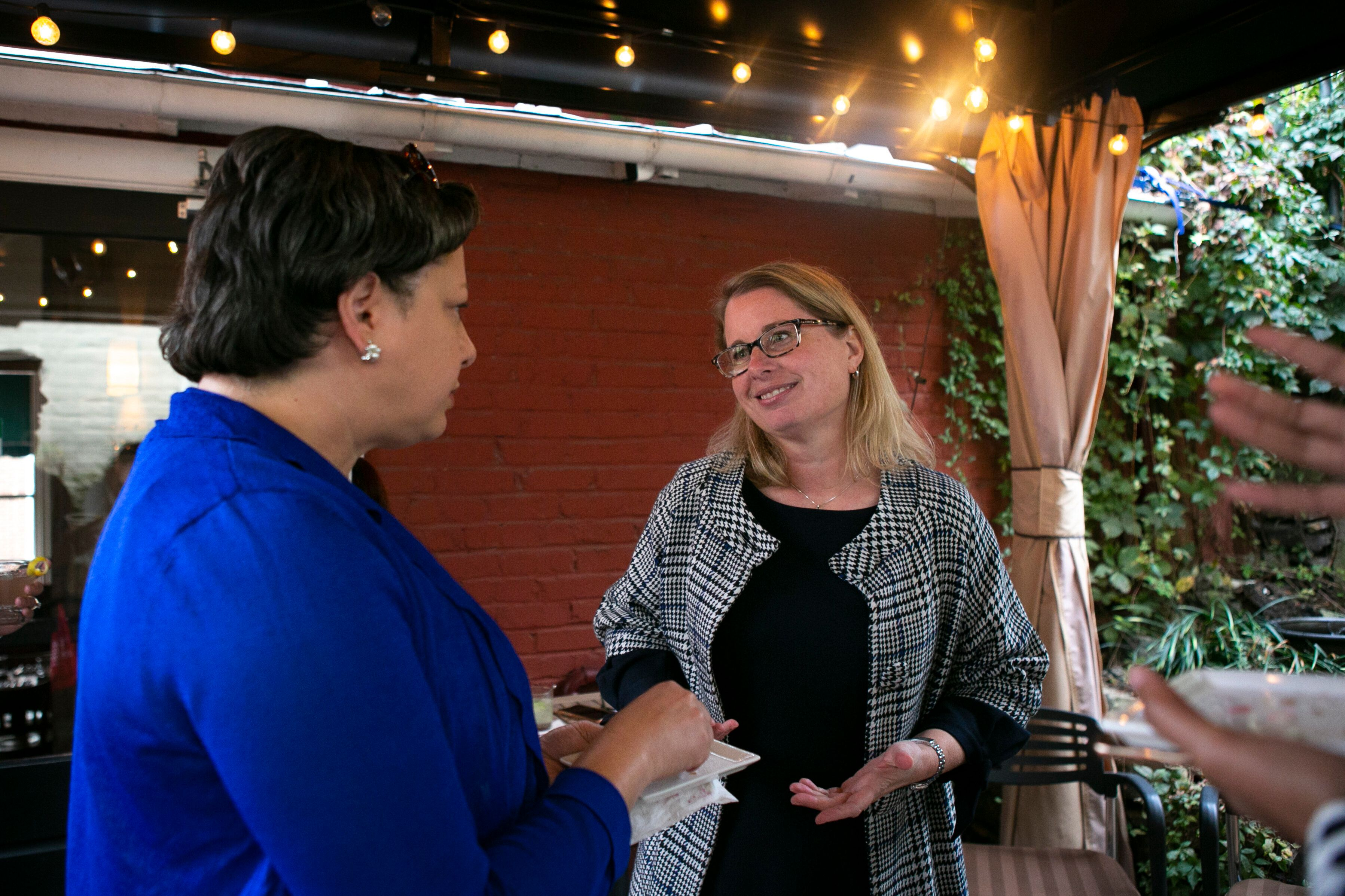 Virginia state Sen. Jennifer McClellan (D), left, campaigns for a state House candidate in 2019. McClellan has represented th