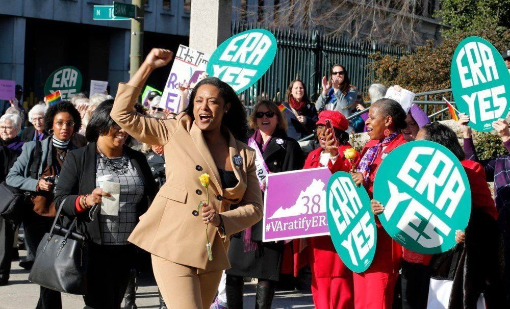 Jennifer Carroll Foy, center, cheers on supporters of the Equal Rights Amendment. Carroll Foy is one of two Virginia candidat