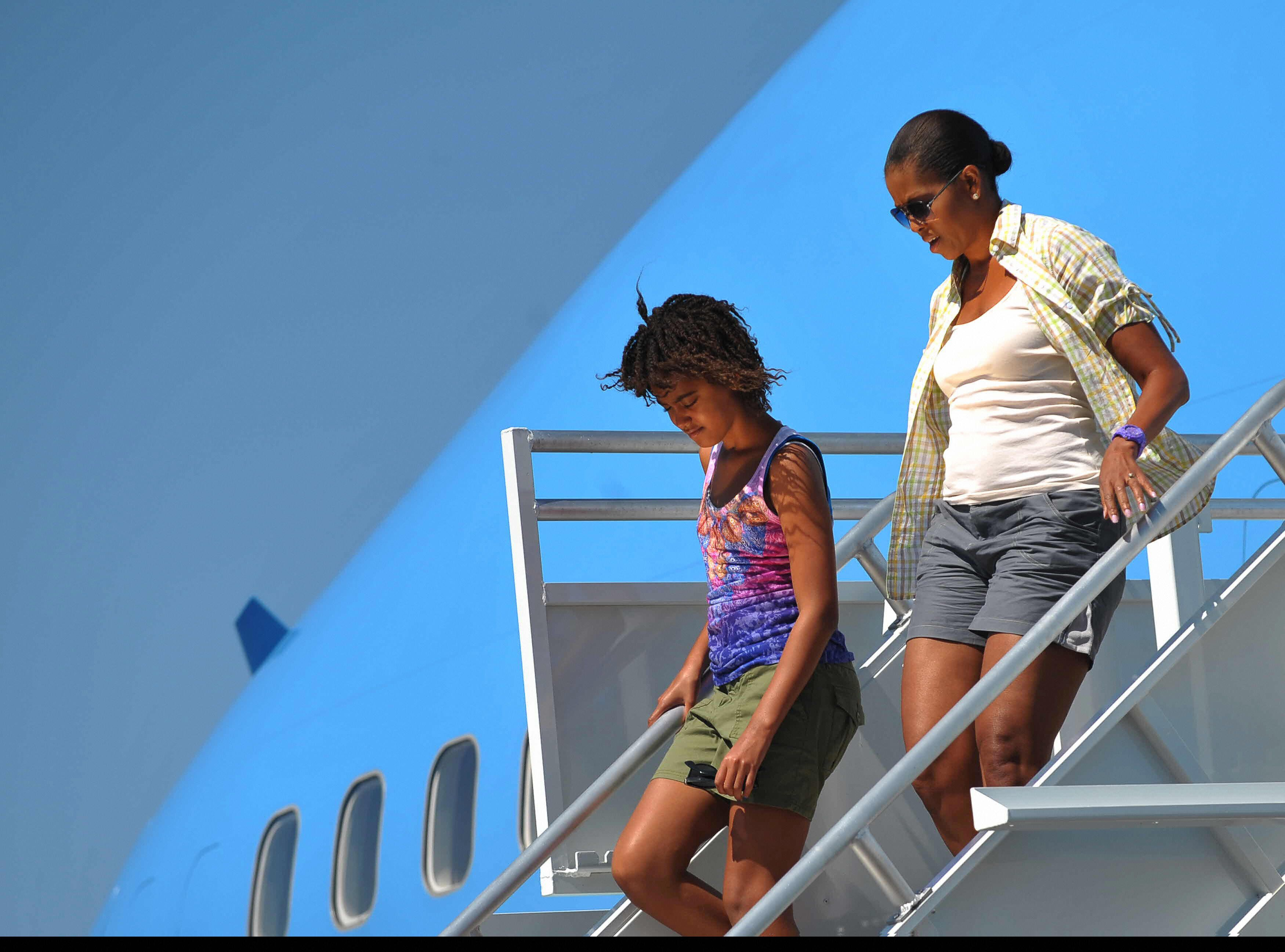 First lady Michelle Obama and daughter Malia step off Air Force One August 16, 2009, upon arrival at Grand Canyon National Pa