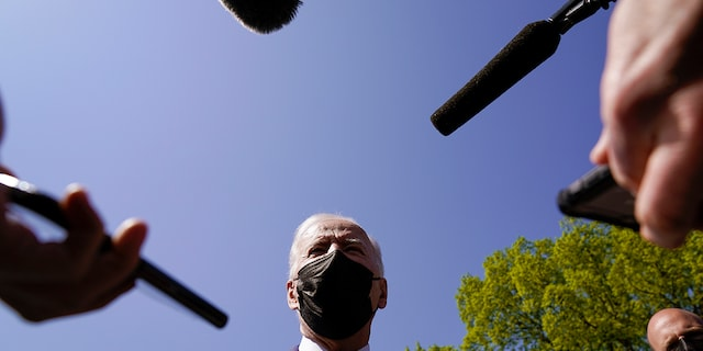 President Biden speaks to members of the media after arriving on the Ellipse on the National Mall after spending the weekend at Camp David, Monday, April 5, 2021, in Washington. (AP Photo/Evan Vucci)