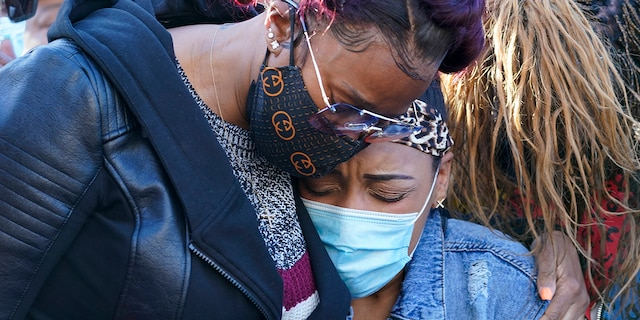 DMX'S ex-wife, Tashera Simmons, left, and his fiancé Desiree Lindstrom embrace during a prayer vigil outside of White Plains Hospital on Monday, April 5.