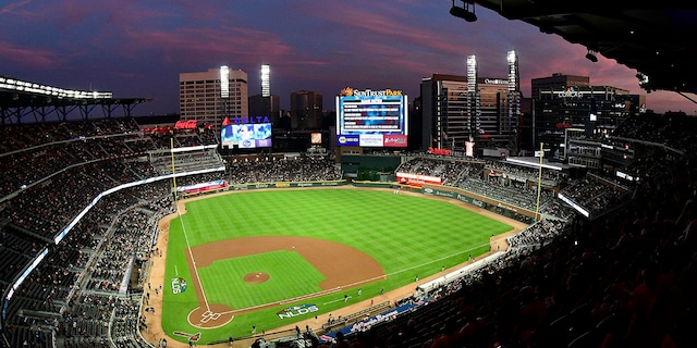 Ground crews prepare the field at Sun Trust Park, now known as Truist Park, ahead of Game 3 of MLB baseball's National League Division Series between the Atlanta Braves and the Los Angeles Dodgers in Atlanta on Oct. 7, 2018. (Associated Press)