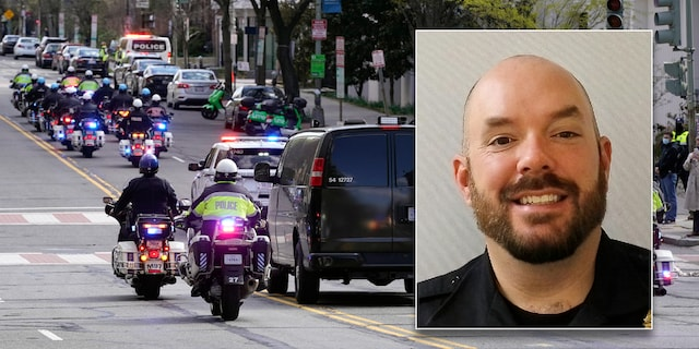"""A procession carries the remains of a U.S. Capitol Police officer who was killed after a man rammed a car into two officers at a barricade outside the U.S. Capitol. Police identified the fallen officer as William """"Billy"""" Evans."""