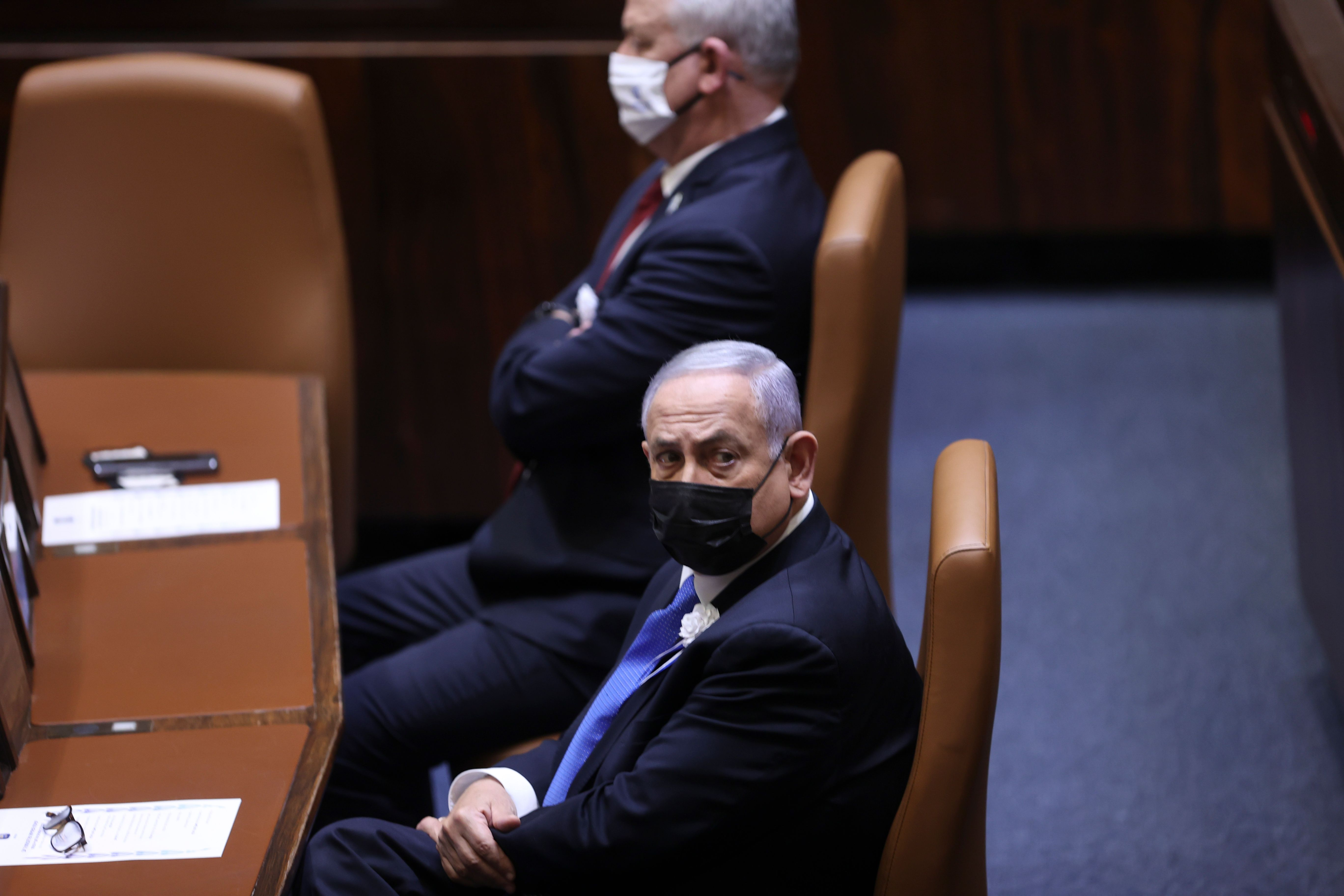 Israeli Prime Minister Benjamin Netanyahu, front, attends the swearing-in ceremony for Israel's 24th government, at the Kness