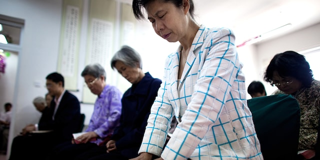 Members of the house church Xin Mingling meet for Sunday service May 15, 2011 in Beijing, China. (Jonathan Saruk/Getty Images)